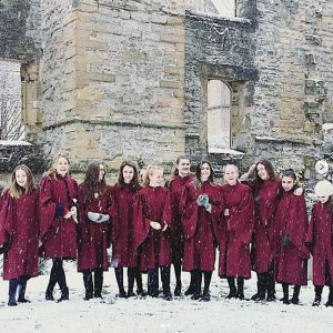 Girl choristers in the snow